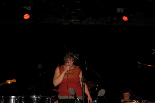 Tune Yards had tape across the front of her face (possibly for sound effects?).  The rest of her band also wore tape when they joined her later.  Has anyone seen this before?/know what the tape is for?