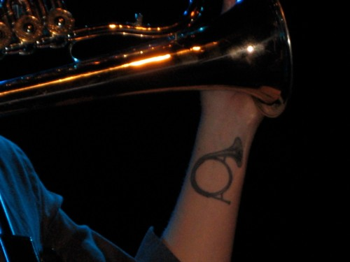 Zach has identical French horn tattoos on both wrists.  They're a little large for my taste, but they looked good/appropriate on him.
