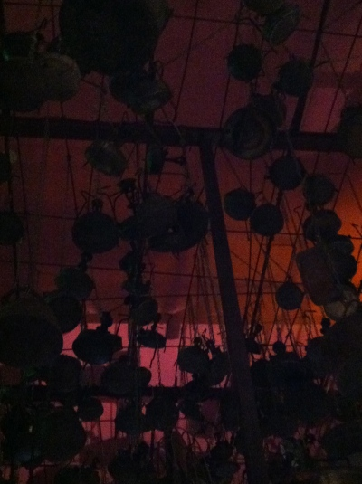 Pots on the ceiling of Dr. Shakshuka